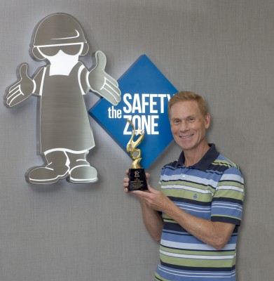 Jeff Ignatuk displays The Safety Zone's gold award from The United Group